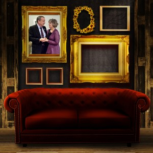 Gallery display - vintage gold frames on an old timber wall and red sofa